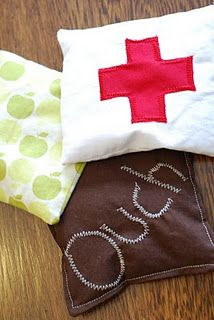ouch bag! does your kid think they need a band aid for everything? make an ouch bag! keep it in the freezer so it is always cold when needed! SMART!