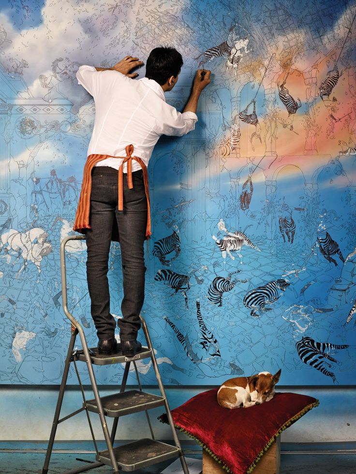Raqib Shaw, who is photographed here working on Paradise Lost. --Tumblr