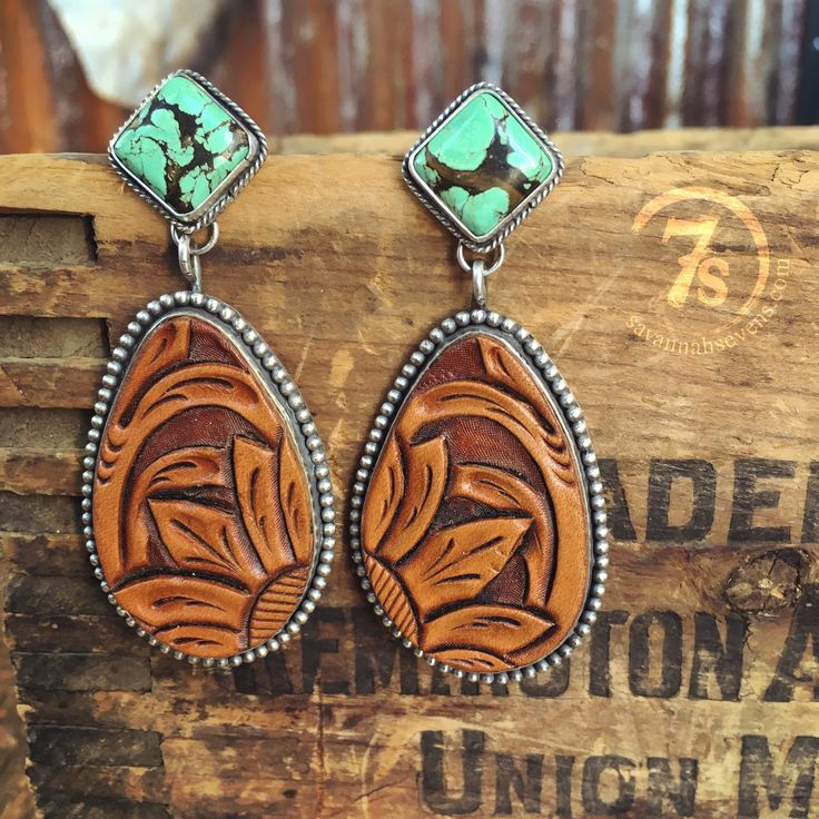 Tooled leather and tuquoise earrings Teardrop detailed hand tooled leather Solid…