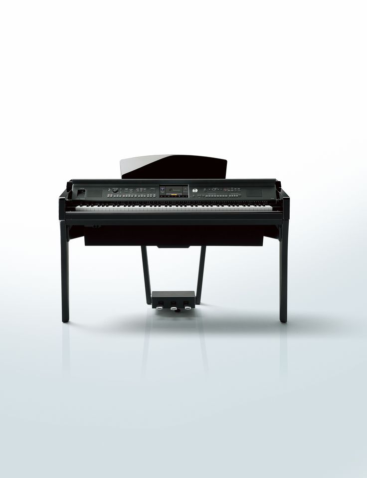 Yamaha Clavinova CVP-609 digital piano in a polished ebony finish.