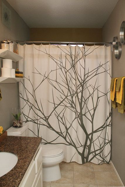 love how the shower curtains make the bland wall color look classy. The bright mustard and olive color towels really POP and add character.