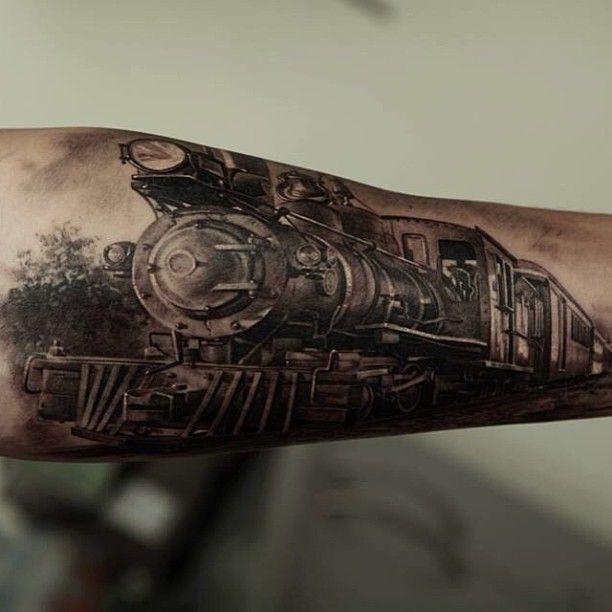 Tattoo by Dmitriy Samohin  I've been thinking about getting a tattoo of an old school train for my son and with his name added somewhere on it. I just love how real this looks :)