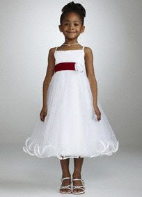 Spaghetti strap tulle tea length ball gown features darling feed through flower at waist.  Gorgeous banded hem on full tulle skirt finishes off the look.  Available in White. Sizes 2T-14.  Shown with removable sash, S1041 (sold seperately).  Fully lined. Imported polyester. Dry clean.