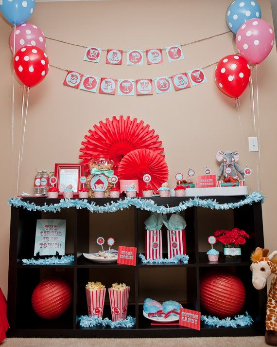 Circus Party Table-like the tissue paper decorations and bringing in the stuffed animals