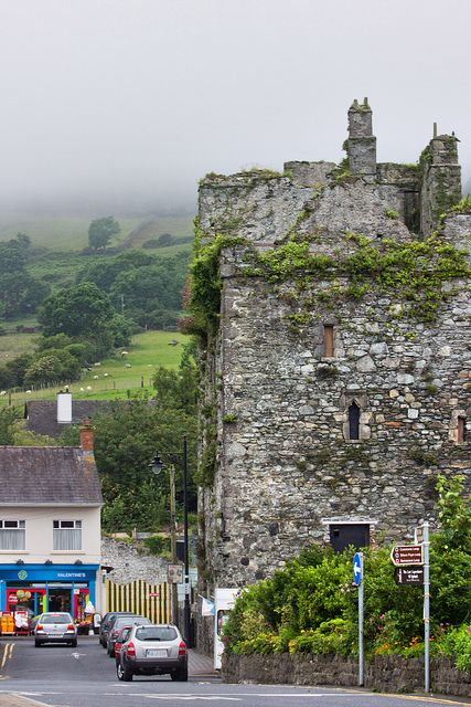"Taaffe's Castle, also known as King John's Castle, Carlingford, Co Louth, Ireland | Carlingford (from Old Norse Kerlingfjǫrðr, meaning ""narrow sea-inlet of the hag""; Irish: Cairlinn) is a coastal town and townland in northern County Louth, Ireland. Carlingford has a number of mediaeval streets — the main one being Tholsel Street which holds the remnants of an old Toll Gate and a Mint. Wikipedia"