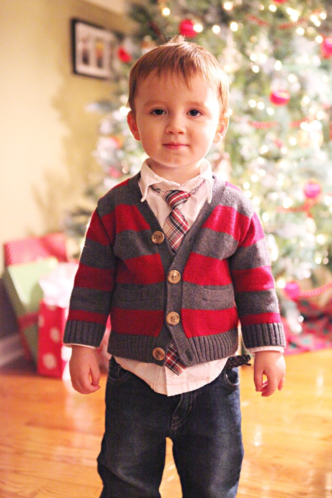 Jackson has this little cardigan... but now I need to get him a white shirt with a collar and a tie... but I would love a bowtie!!: