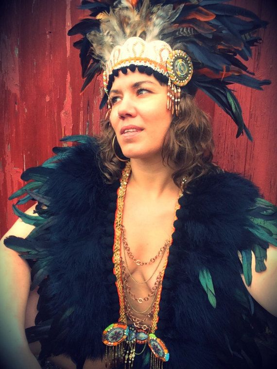 Warrior woman festival feather and chain breastplate. Burning Man vibes. Burning Man style. Shop www.wildthing.com and https://www.etsy.com/uk/shop/feathersandthreaduk