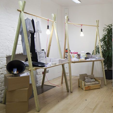 A-frame table supports: great way to have somewhere to hang signage and lighting, as well as suspending items for sale