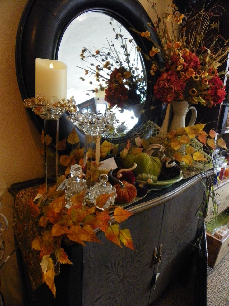 Decorate your buffet with fall leaves, fruits and Luminara flame effect pillars.