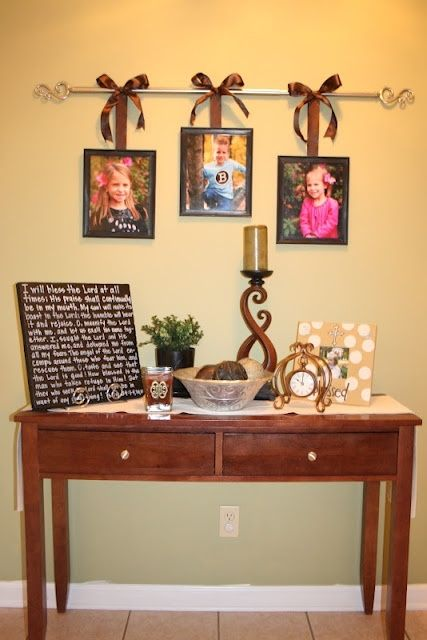 Curtain Rod to hang pictures.
