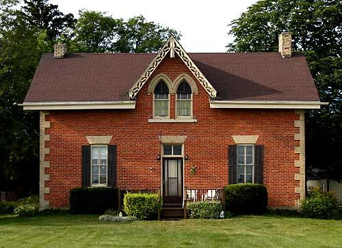 Stratford    Here is a rare example of a Gothic Revival residence using red brick instead of stone with white detailing.    The gable has a rare version of the double lancet window.