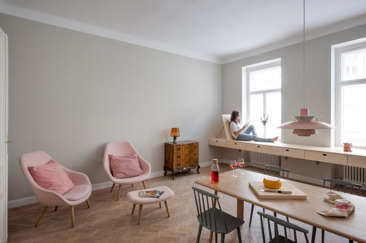 This Vienna apartment renovated by Slovenian architects Kombinat features a hybrid living space with room for both cooking and working.