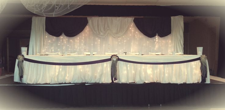 Beautiful purple satin and gold organza themed head table.