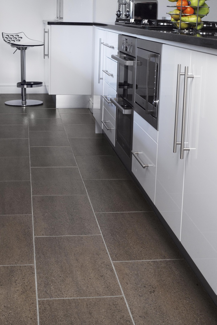 SIGNATURE LAVASTONE  A contemporary stone effect tile, with irresistible aubergine shades   and tones and a soft lineal detail. Complemented with a robust   slate surface texture makes this product both highly durable and practical. Available from Rodgers of York #Interiors #Flooring