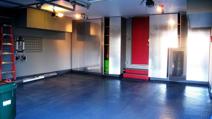 This garage was remodeled and redesigned by 7J design.  Ample space and storage was added along with a fun red door.