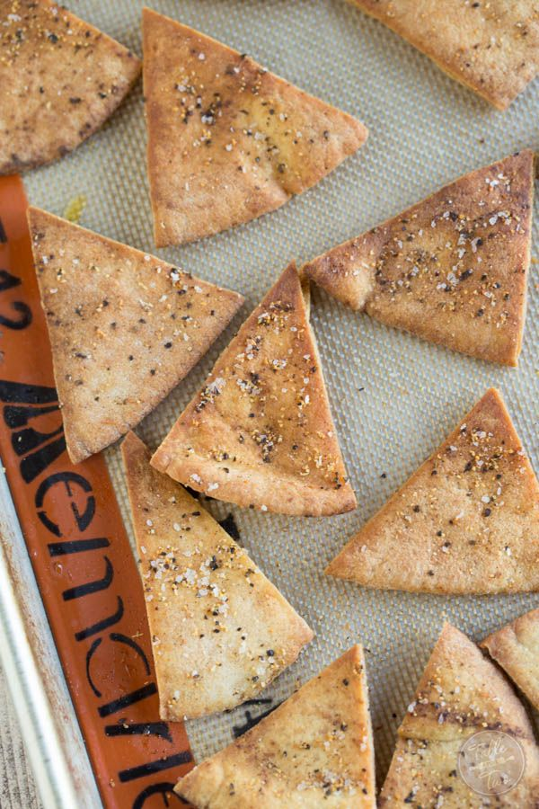 Homemade seasoned pita chips are so easy to make and perfect to pair with your favorite dip! Make these for your next game day or television binge day!