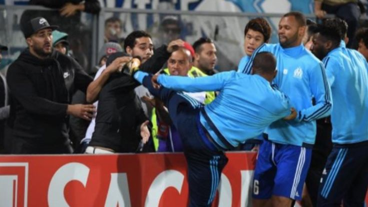 nice Patrice Evra (Olympique de Marseille) kicks a fan in the head and gets a red card before the game start while he was not even on the roster Check more at https://www.matchdayfootball.com/patrice-evra-olympique-de-marseille-kicks-a-fan-in-the-head-and-gets-a-red-card-before-the-game-start-while-he-was-not-even-on-the-roster/
