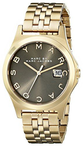 Marc by Marc Jacobs Women's MBM3349 Gold-Tone Stainless Steel Bracelet Watch. Gold-tone bracelet watch featuring sunray dial with logo hour markers and magnified date window. 36 mm stainless steel case with mineral dial window. Quartz movement with analog display. Stainless steel band with deployant-clasp closure. Water resistant to 50 m (165 ft).