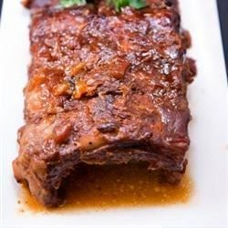 Tender beef ribs in homemade barbeque sauce are ready in 4 hours of slow cooking, but are even tastier if you cook them for 8 hours. Serve over hot cooked rice.