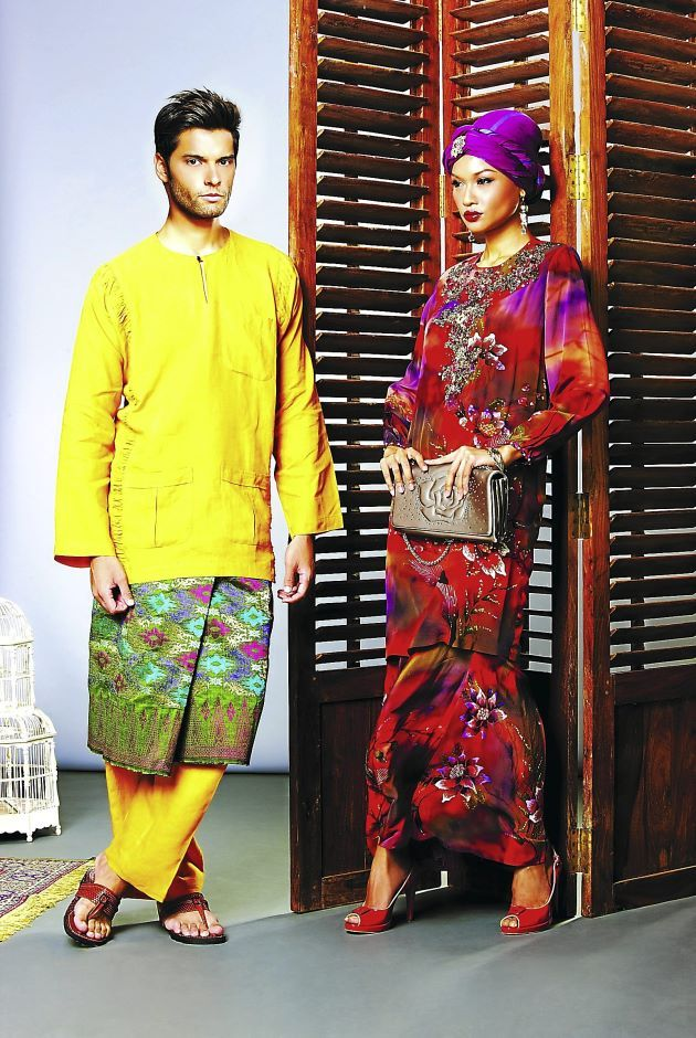 She wears a baju kurung from Ratu, with handbag from Tosca Blu while he is in a baju Melayu from Linenopolis, songket from Bac Medacena and ...