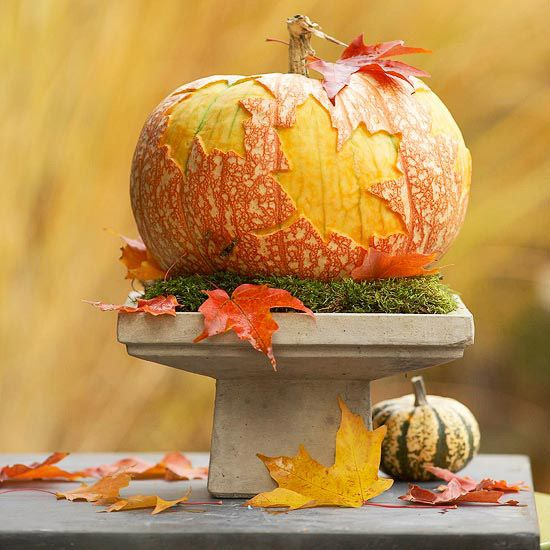 Traced-Leaf Pumpkin Centerpiece Use a large leaf to trace onto a pumpkin and use a scraping tool to cut away only the outermost layer. Set it on a bed of moss and a pedestal for a centerpiece that will last all season. Get the carving pattern.