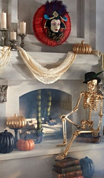 This Temptress Mantel Scene invites guests to the party, who take creepy couture well beyond traditional orange and black.