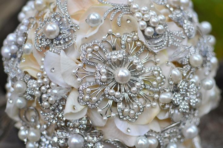 Pearl and ivory brooch wedding bouquet deposit on a par Noaki
