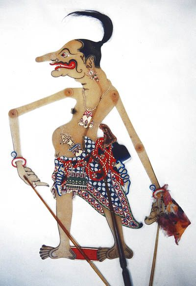 Petruk is the tallest of the Punakawan, a family of characters generally represent the commoners in Javanese Wayang. The other three are Semar, Gareng, Bagong. In Balinese wayang, the Punakawan characters are Malen and Merdah (the maids of Pandawa) and Delem and Sangut (the maids of Kurawa)