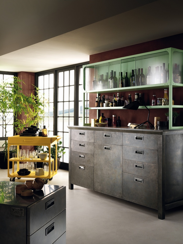 Diesel Social Kitchen design by Diesel. Vintage and innovation? Materials and finishes all have that well-used look: steel is aged, and the types of wood used are all processed to convey a time-worn look and feel; the wired glass and handles reinforce this retro concept. #DieselSocialKitchen #Diesel #Scavolini #Kitchen