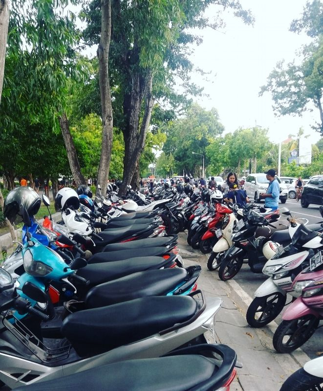 Motorbikes in Denpasar, Bali, Indonesia. Click through to discover the park the…