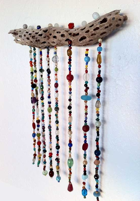 Beaded Suncatcher using glass beads, found objects, shells. Easy project that would be great for kids. Gift idea glass beads: http://www.ecrafty.com/c-2-glass-beads.aspx