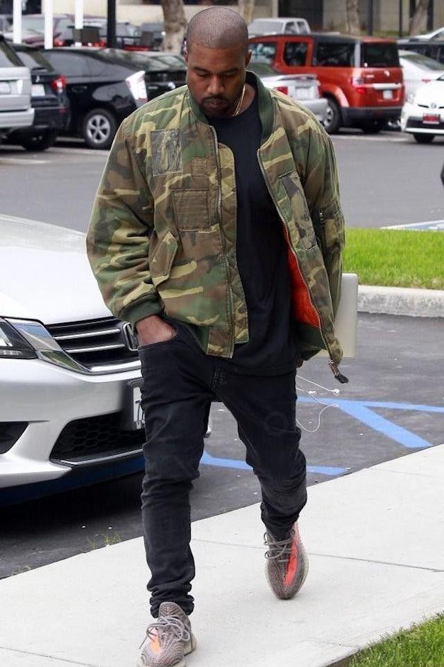 Kanye West wearing  Adidas Yeezy Boost 350 Season 3, Acne Ace Used Cash Jeans, Raf Simons Manics Camouflage Jacket