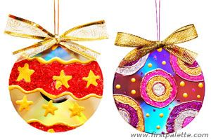 CD ornaments with puffy paint on shiny side of CD.  cool idea.