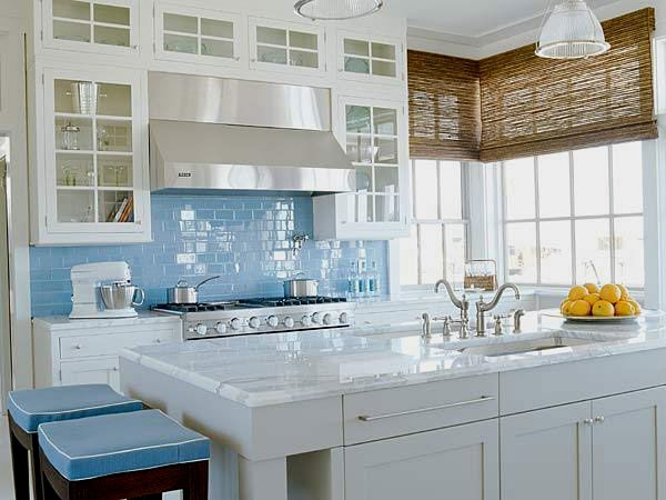 A soft blue backsplash [from 30 Examples Of How To Add Subway Tiles In Your Kitchen]