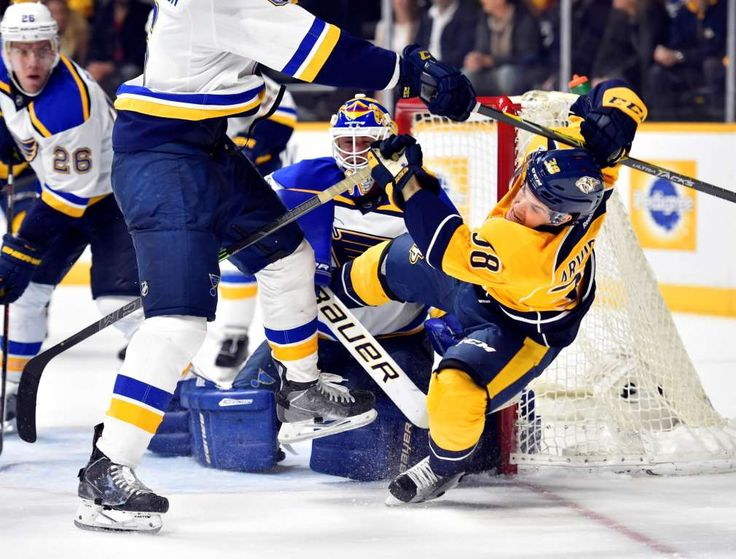 Hit by a Blues:   Nashville Predators right winger Viktor Arvidsson (38) is hit by St. Louis Blues defenseman Joel Edmundson (6) after attempting a shot during the third period at Bridgestone Arena on Feb. 2. The Blues won 1-0.    -      © Christopher Hanewinckel/USA TODAY Sports