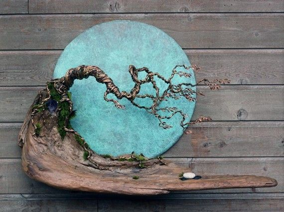 Blue Moon in October Wall Sculpture is designed and hand crafted by artist Marshall Mar of Mars Metal Art.  The Blue Moon in October Wall Sculpture is really unique and special, its balance creates a sense of well being and evokes visions of weathered west coast rainforest trees. The Blue Moon diameter is 27, the full size is 45 x 32-1/2 x 12 wide and is made with 100% recycled materials that include copper, bronze, west coast driftwood, one of a kind beach stones and a very large amethyst…