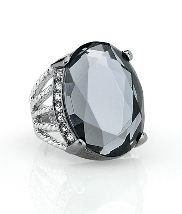 Lia Sophia Lunette Ring is a hematite setting that holds tight to a knockout stone of intensely reflective black diamond glass. The polished silver band breaks open to meet up with a channel of clear cut crystal diamonds on both sides of the stone.