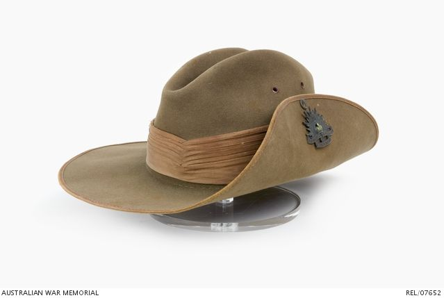 """Australia Army slouch hat with badge, puggaree and 9 Division """"T"""" colour patch worn by NX12149 Sergeant Horace William Mills, HQ 9 Australian Division."""