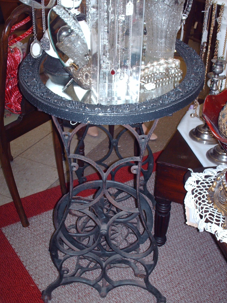 old iron sewing machine legs with mirror attached for a top - perfect as a side table or bar, Old Fiddle Dee Shoppe in Chickamauga, Ga.
