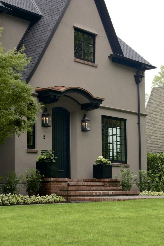 Laurelhurst House Front Door - The body is color Benjamin Moore AC-36 Shenandoah Taupe. The trim is a warm black selected to blend — sbrandtlieb: