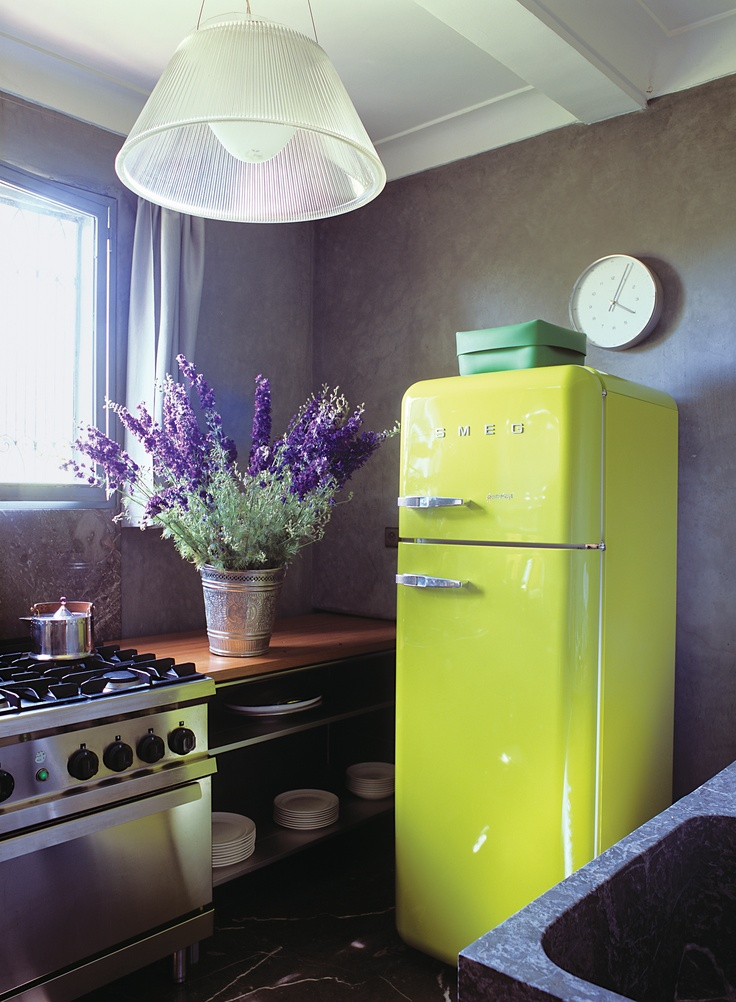 """As seen in Urban County Style - """"Nowadays, retro style can come with a warranty. A smart citron refrigerator from Smeg provides a shot of color in this tine kitchen, which features plenty of open shelving and metal and wood work surfaces.""""  www.amazon.com"""