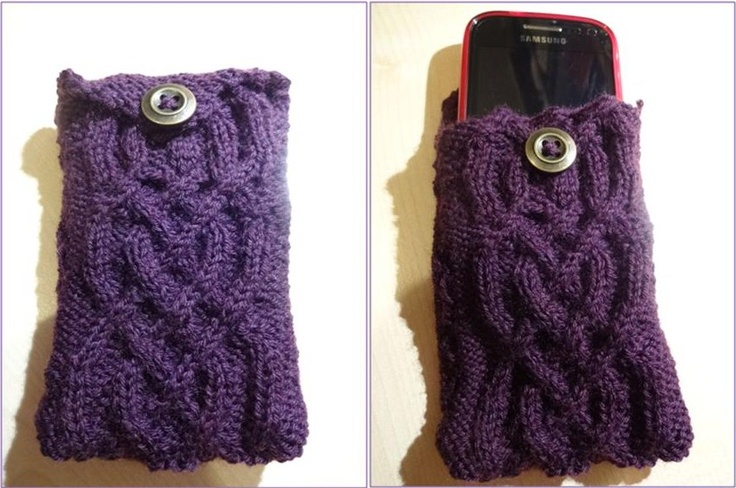 This is the phone cover I've just knitted for my new phone (I've never tried travelling cable before so that's why there's a mistake part way up!) Pretty and functional, so it doesn't get scratched in my bag. I used the cabling design from the website link below, then   improvised a bit to turn it into a case design. http://www.knit1take2.com/2010/03/pack-your-bags-were-travelling/