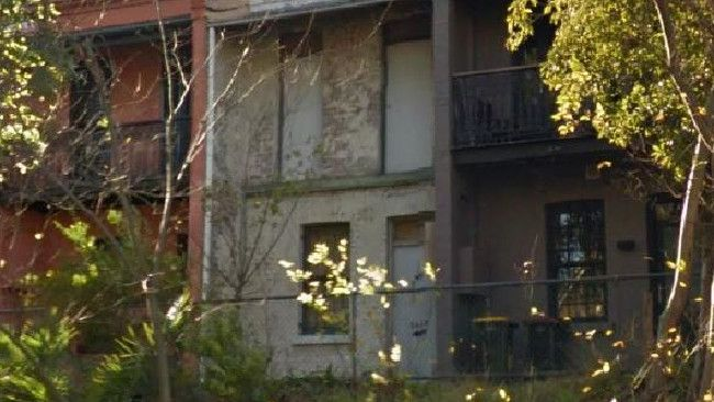 A SQUATTER who took over a dilapidated terrace in inner-city Sydney has abandoned his bid for adverse possession.