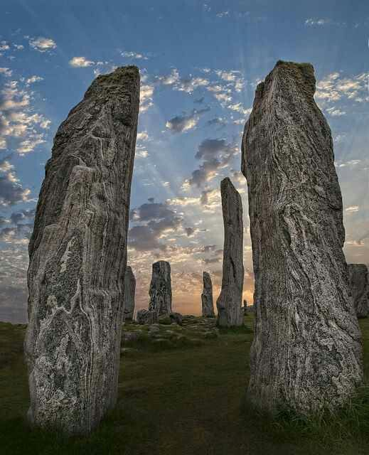 """The Callanish Stones (or """"Callanish I"""", Clachan Chalanais or Tursachan Chalanais in Gaelic) are an arrangement of standing stones placed in a cruciform pattern with a central stone circle. They were erected in the late Neolithic era, and were a focus for ritual activity during the Bronze Age. They are near the village of Callanish (Gaelic: Calanais) on the west coast of Lewis in the Outer Hebrides, Scotland.  LOVE this place, can't wait to return."""