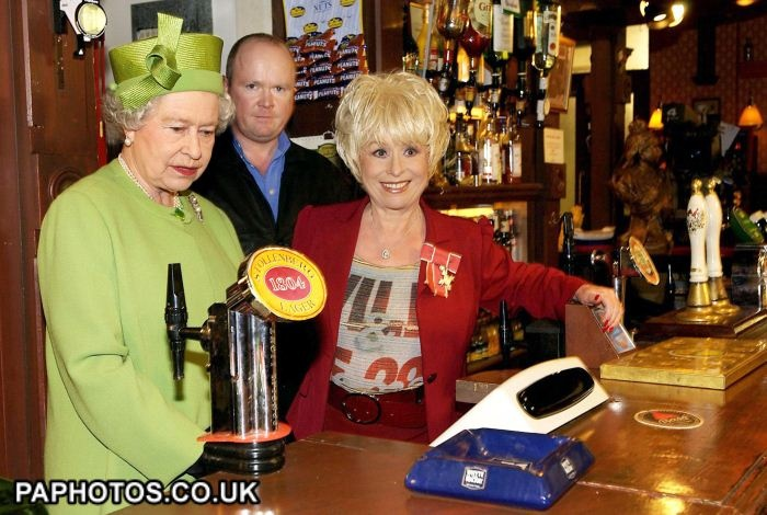 The Queen visits Eastenders Set at the Queen Vic with Phil (Steve McFadden) and Peggy Mitchell (Barbara Windsor)