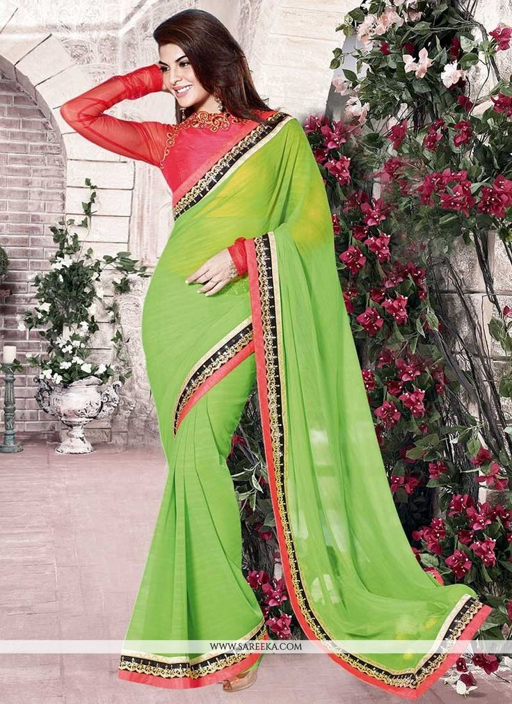 Look ethnic in this Jacqueline Fernandez green georgette casual saree. The embroidered and lace work on attire personifies the entire appearance. Comes with matching blouse. (Slight variation in color...