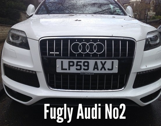 FUGLY Audi SUV's are even worse in white when the ham fisted detailing becomes clear. Note Audi logo perfectly positioned to crush a child's skull.