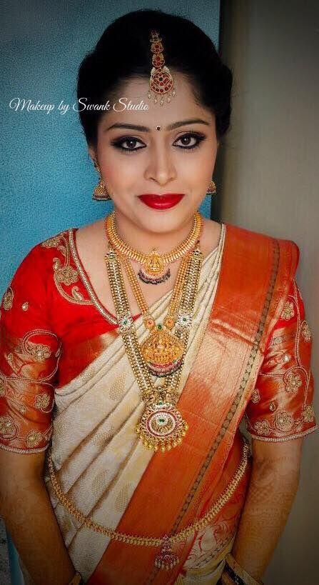 Traditional Southern Indian bride, Hema wears bridal silk saree and jewellery for her Muhuratam. Makeup and hairstyle by Swank Studio. Red lips. South Indian bride. Eye makeup. Bridal jewelry. Bridal hair. Silk sari. Bridal Saree Blouse Design. Indian Bridal Makeup. Indian Bride. Gold Jewellery. Statement Blouse. Tamil bride. Telugu bride. Kannada bride. Hindu bride. Malayalee bride. Find us at https://www.facebook.com/SwankStudioBangalore