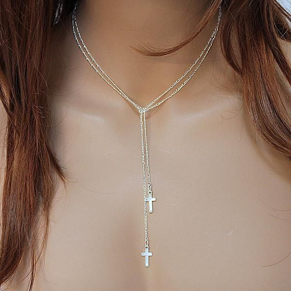 If you have trouble with clasps, this necklace is for you - No clasp to fuss with! This long lariat can be worn several ways. With two pretty crosses, one on either end of the long sterling silver cha