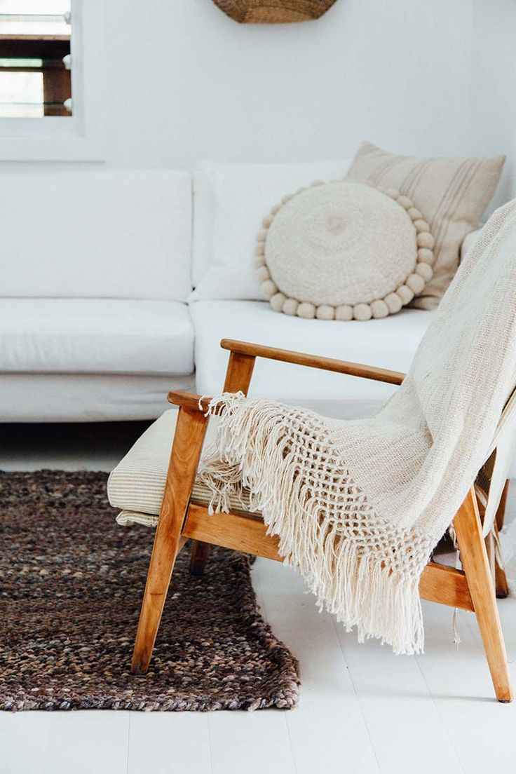 We love the addition of throws draped over occasional chairs